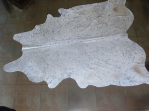 White silver grey cow hide carpet