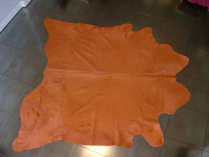 Orange cow hide carpet